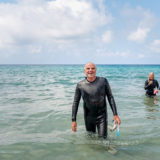 Older man coming out of the sea satisfied after a swim