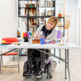 disabled woman in a wheelchair learning to paint